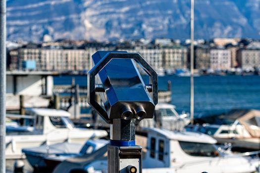 Tourist binoculars on the shores of Lake Geneva, Geneva, Switzerland - image