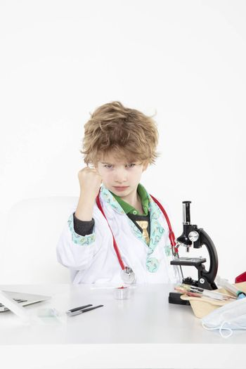 busy young doctor shows a fist to you