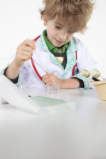 young doctor puts a blood sample on a glass slide