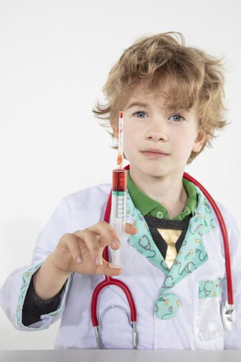 young doctor holds a syringe in his hand filled with vaccine