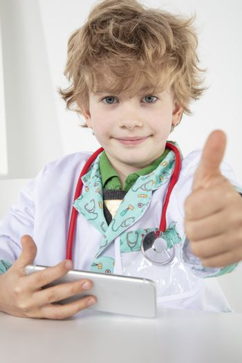 busy young doctor shows thumbs up, a symbol of good luck