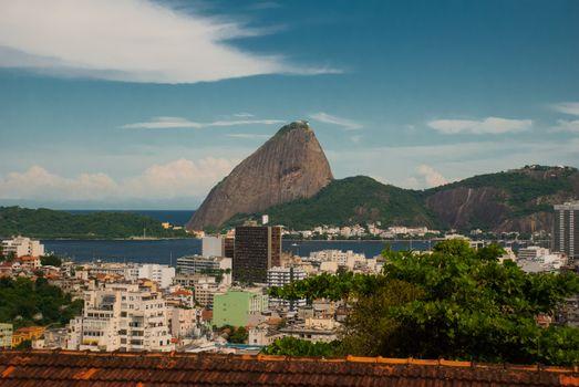Brazil, City of Rio de Janeiro, Santa Teresa Neighbourhood, View over Catete and Flamengo towards Sugarloaf Mountain from Parque das Ruinas. America