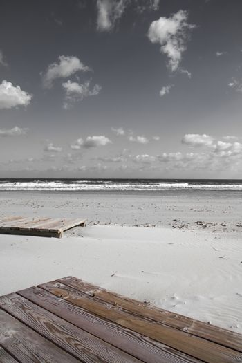 Boardwalk in the winter sea. In the solitude of the finished sea
