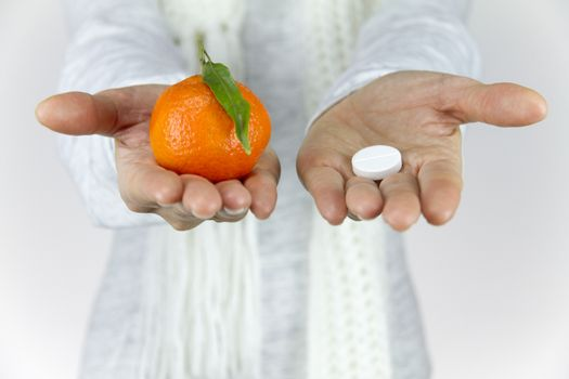 Vitamins from fruit or drugs? A sick young woman with a scarf on
