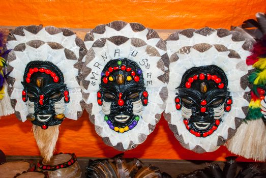 Mask. Souvenirs in the Amazon rainforest made from local nuts and animals near Iquitos. Market for tourists on the Amazon river. Manaus, Amazonas, Brazil