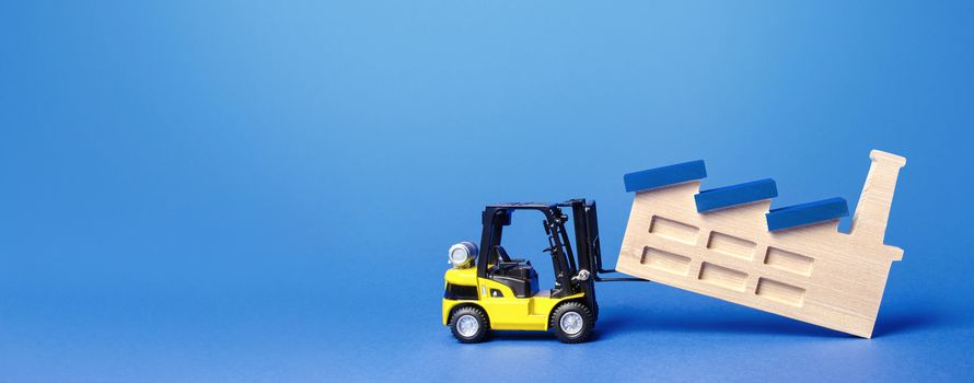 Forklift truck transports a factory plant to new location. Revision of strategy for allocation of production facilities. Change in manufacturing chains. Rejection of heavy dirty industry.