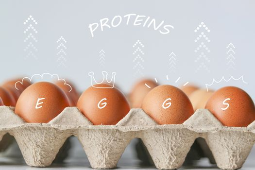 Eggs and arrows that show the high protein value. Eggs with arrow symbol and protein floating above.