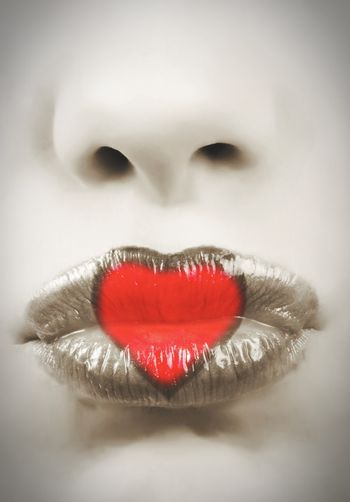closeup of bright red lips with heart.toned picture