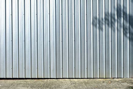 Zinc Wall with Pavement Background.