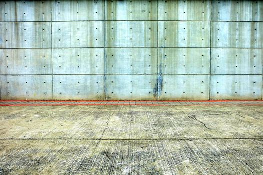 Old Concrete Wall with Pavement.