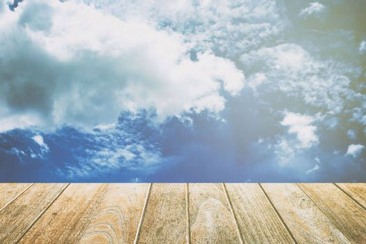 Empty Wooden Pavement with Blue Sky, Clouds, and Light Leak Background. Suitable for Products Display.
