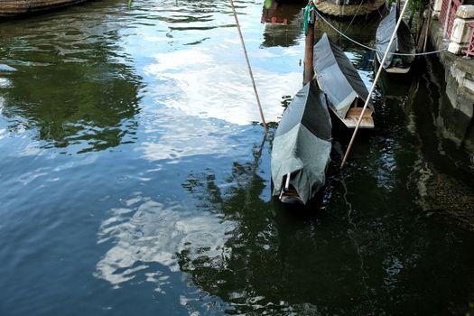 Paddling Boats Floating on Phasi Charoen Canal, Bangkok Thailand.