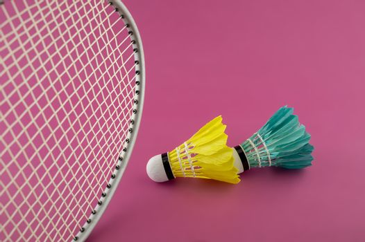Badminton rackets and feathered shuttlecocks