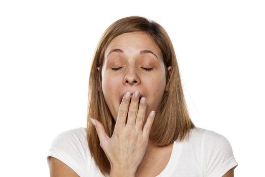 sleepy young woman yawns