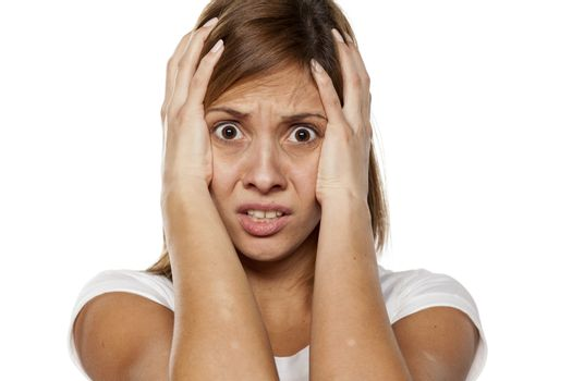frightened and shocked young woman