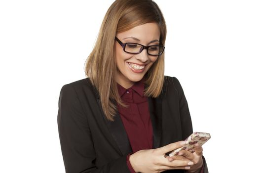 woman writes a text message on her smartphone