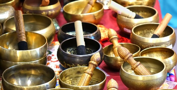 A collection of Tibetan singing bowls with mallets