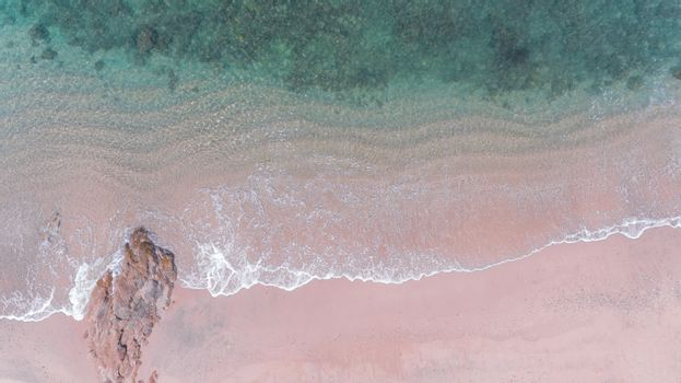 Aerial view of beach with sea wave