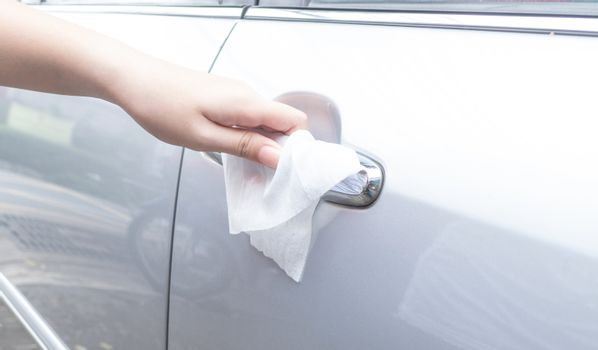 Woman hand cleaning removing germs with antibacterial wet wipes
