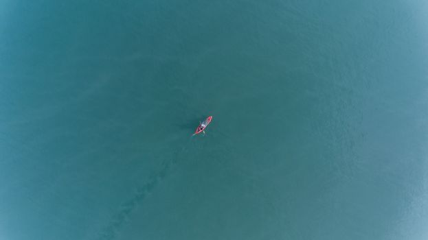 Aerial view of people with kayak over blue sea