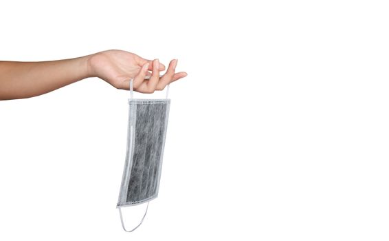 Woman hand is holding an medical facemask over white background,
