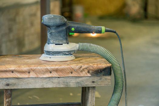 Pneumatic sander machine close up.