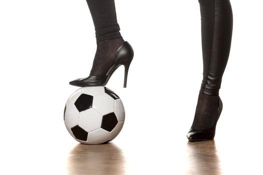 High heels and soccer ball