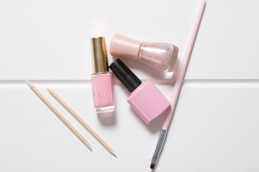 Manicure. Pink nail polishes on a white background. French. Nail salon, procedure, SPA. Home nail care. Manicure tools. Beauty, lifestyle, Glamour. Set, kit