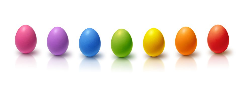 Rainbow colored Easter eggs aligned, isolated on white