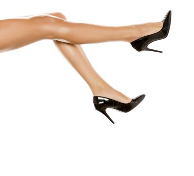 Smooth, long female legs and high heels