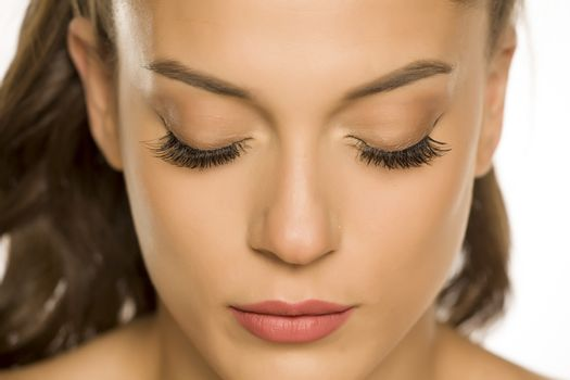 woman with closed eyes and eyelash extension