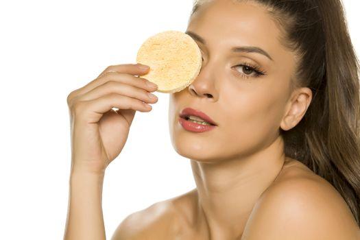 woman posing with a sponge pad