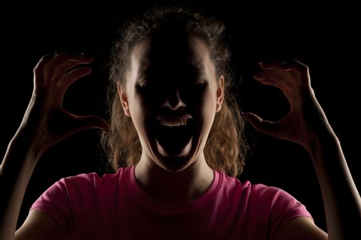 screaming woman with the face in the shadow
