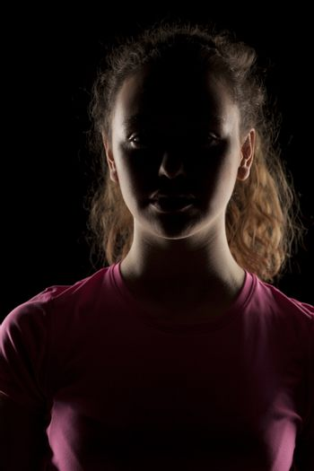 portrait of a girl with the face in shadow