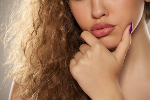 female lips, hand and nose
