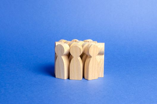 A crowd of wooden figures of people. Social survey and public opinion, electorate. Population and citizens. Society, social group. management of people. investing in human resources. Faceless crowd