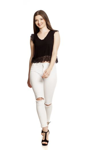Young woman in white jeans and high heels
