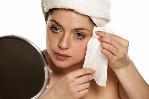 woman removing makeup with the wet wipes