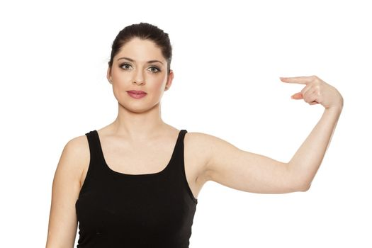 Young beautiful woman pointing at her self