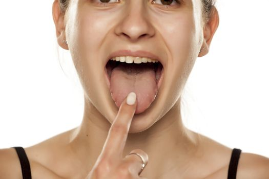 young woman touchimg her tongue