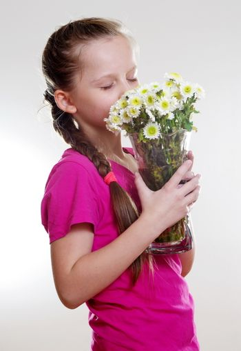 pretty girl with flowers in vase