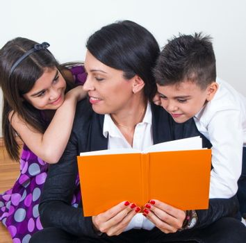 mother with children reading together