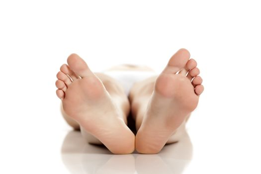 female bare feet on white