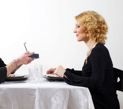 man presenting  the gift to woman