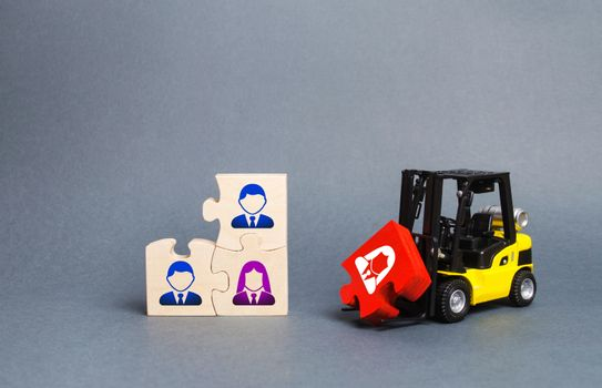 A forklift truck carries a red puzzle to the unfinished assembly of business team. Search, recruitment staff, hiring leader. Creating an efficient and productive business unit. Leadership and teamwork