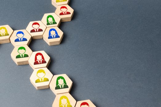 Symbols of employees on the chains of hexagons. business connections. Team building, business organization and staff hierarchy. Selection of applicants for work, the formation of teams and departments