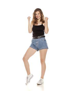 pretty happy woman in short jeans
