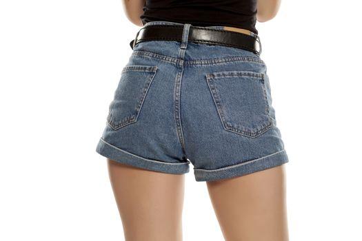 Female butt in short jeans