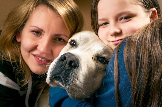 Happy family with the dog