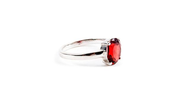 Ring with the red ruby stone isolated on white